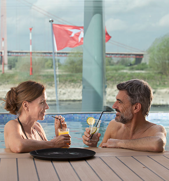 Couple on-baord Emerald Cruises by the Pool