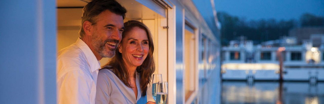 Couple on Emerald Waterways Grand Balcony Suite